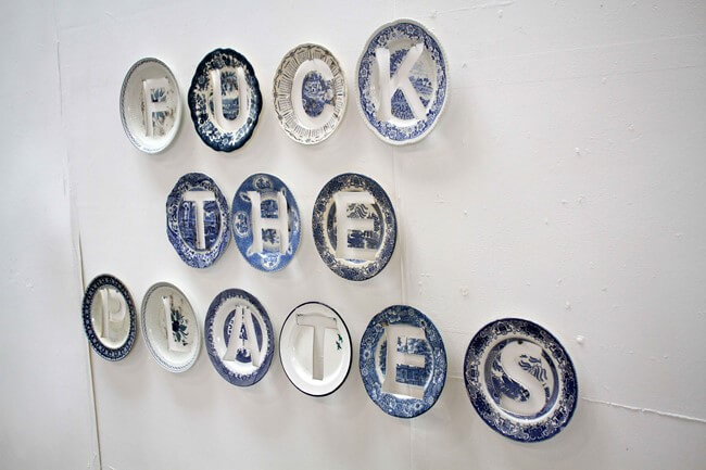 F**k the police. 2012. Mimicry of original graffiti in waterjet cut delft plates